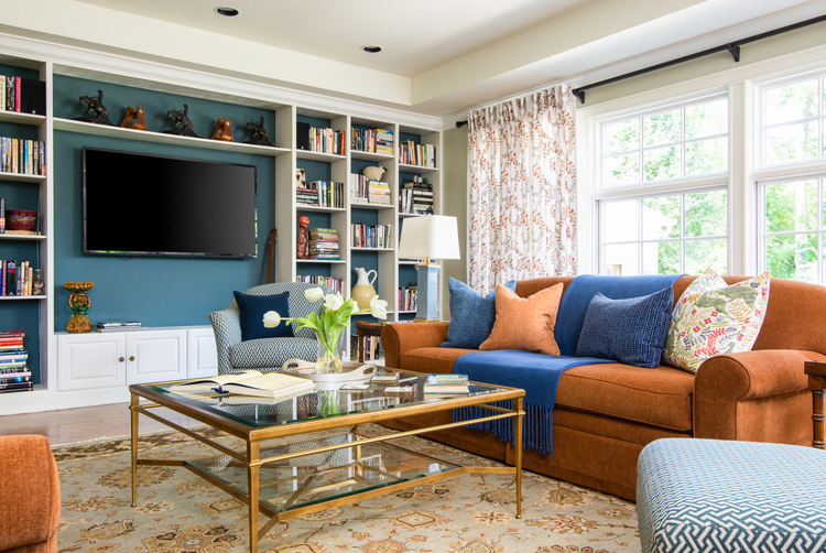 dark blue in the back of a bookcase to take the emphasis off the television in a room with multiple focal points
