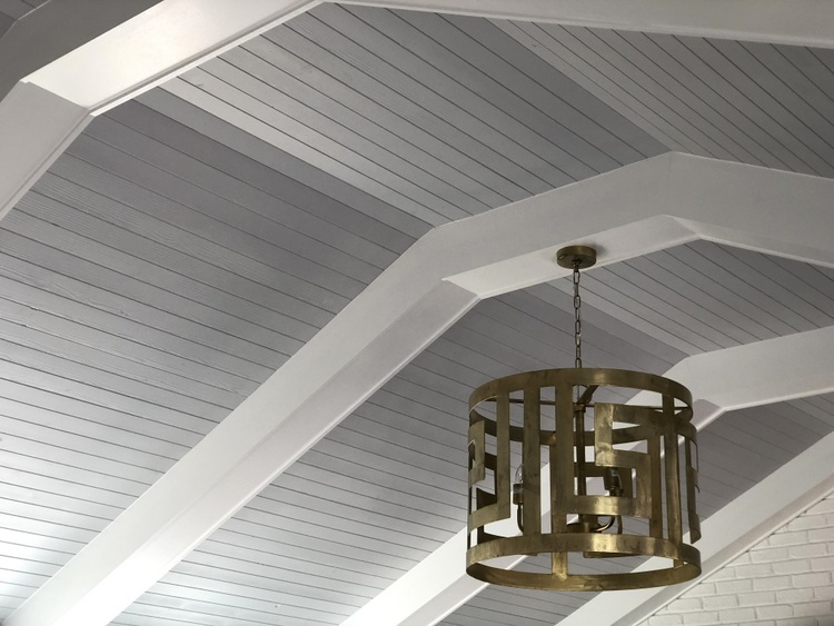 white beam vaulted ceiling with gold light fixture