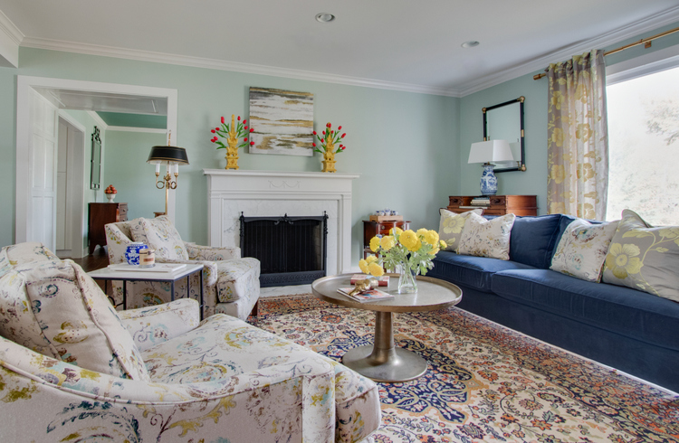 navy sofa and oriental rug in living room makeover
