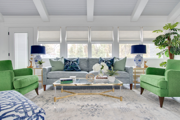 blue cr laine sofa and green art deco chairs