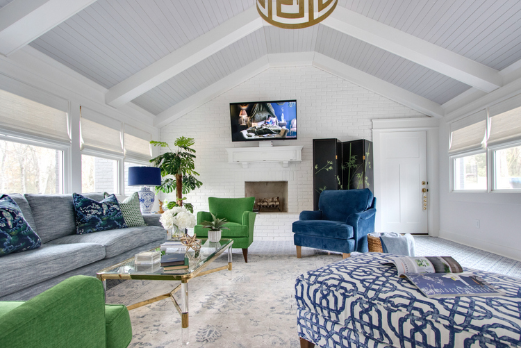 white painted brick in blue and green living room design