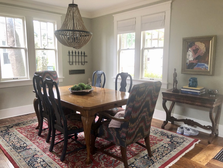 mixing old and new in a gray green dining room