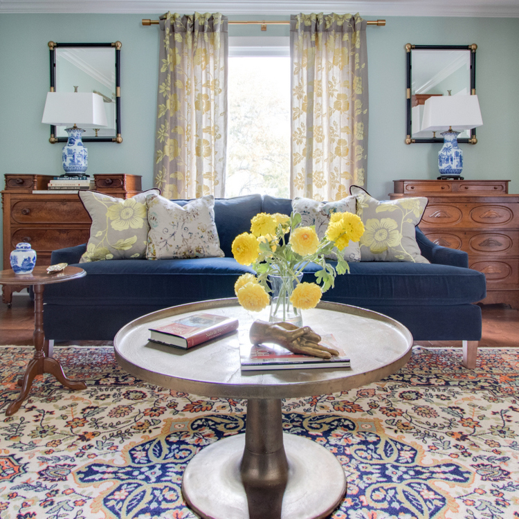 nashville living room design with navy sofa and chinoiserie lamps